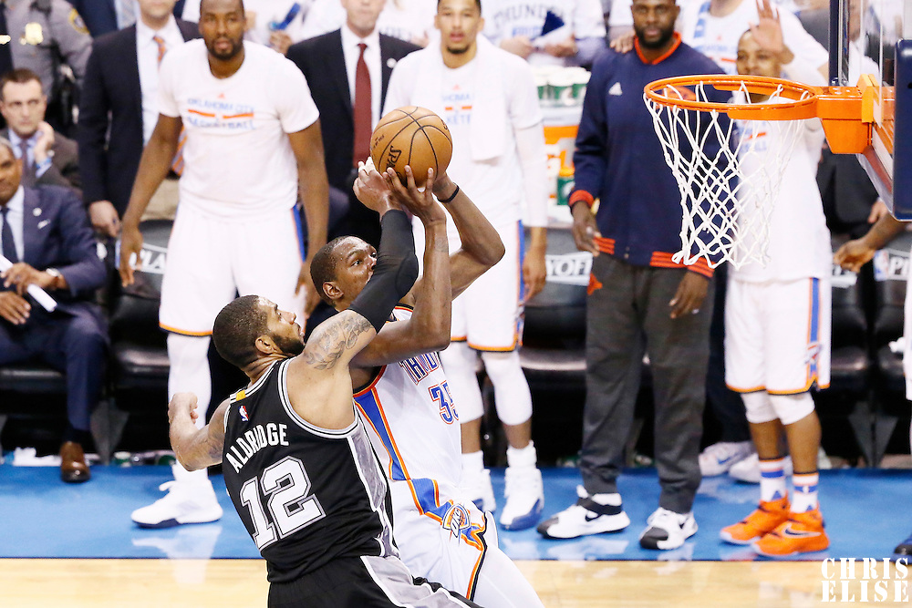 08 May 2016: Oklahoma City Thunder forward Kevin Durant (35) goes for the dunk against San Antonio Spurs forward LaMarcus Aldridge (12) during the Oklahoma City Thunder 111-97 victory over the San Antonio Spurs, during Game Four of the Western Conference Semifinals of the NBA Playoffs at the Chesapeake Energy Arena, Oklahoma City, Oklahoma, USA.