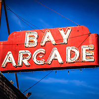Picture of Bay Arcade sign on Balboa Peninsula in Newport Beach California. The Bay Arcade is located in the Balboa Fun Zone in Orange County Southern California.