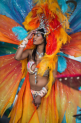 © Licensed to London News Pictures. 31/08/2015. London, UK. Revellers braved three wet conditions on day two of the Notting Hill Carnival in West London. The annual event, dating back to 1966, is one of the world's largest street festivals, attracting over one million people. Photo credit: Ben Cawthra/LNP