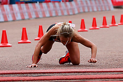 © Licensed to London News Pictures. 28/04/2019. London, UK. British athlete Hayley Carruthers falls down just before the finish line at the London Marathon 2019. Photo credit: Dinendra Haria/LNP