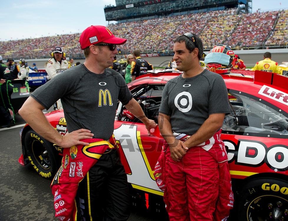 Brooklyn, MI - JUN 17, 2012: Jamie McMurray (1) and Juan Pablo Montoya (42) during the Sprint Cup Quicken Loans 400 race at Michigan International Speedway in Brooklyn, MI.