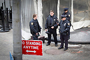 Four NYPD policemen guarding the entrance to the NYSE Euronext Stock Exchange on Wall Street