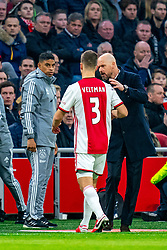 Injured Joel Veltman #3 of Ajax and Coach Erik ten Hag during the match between Ajax and PSV at Johan Cruyff Arena on February 02, 2020 in Amsterdam, Netherlands