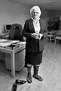 EU Commissioner for Agriculture Mariann FISCHER BOEL in a pair of wellingtons at her office.   Photo: Erik Luntang/INSPIRIT PHOTO