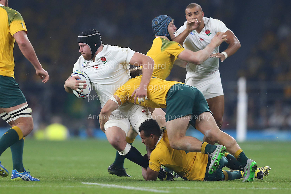 Ben Morgan of England is tackled by Will Genia of Australia and Michael Hooper of Australia. Rugby World Cup 2015 pool A match, England v Australia at Twickenham Stadium in London, England  on Saturday 3rd October 2015.<br /> pic by  John Patrick Fletcher, Andrew Orchard sports photography.
