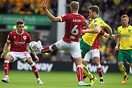 Marley Watkins of Norwich and Nathan Baker of Bristol City in action during the Sky Bet Championship match at Carrow Road, Norwich<br /> Picture by Paul Chesterton/Focus Images Ltd +44 7904 640267<br /> 23/09/2017