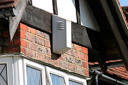 Burglar alarm on house in suburban residential street in Surrey; UK