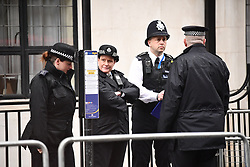 © Licensed to London News Pictures. 03/04/2018. London, UK. Police stand on guard outside the King Edward VII Hospital in central London after The Duke of Edinburgh was admitted. Prince Philip is having a planned operation tomorrow on is hip and is expected to stay for a few days. Photo credit: Ben Cawthra/LNP