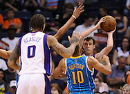 Apr 7, 2013; Phoenix, AZ, USA; Phoenix Suns guard Goran Dragic (1) looks to make a pass to teammate forward Michael Beasley (0) while being guarded by New Orleans Hornets guard Eric Gordon (10) in the second half at US Airways Center. The Hornets defeated the Suns 95-92. Mandatory Credit: Jennifer Stewart-USA TODAY Sports