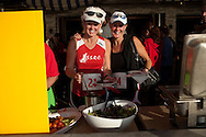 Sandy Guy-Willoughby and Deb Sims get some food at Poseidon restaurant in Del Mar after the Red Nose Run.