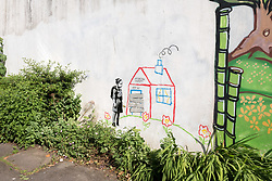 © Licensed to London News Pictures. 27/06/2019. Bristol, UK. A mural in the style of Banksy has appeared on a wall in Bristol, but it has yet to be confirmed as a genuine work by Banksy. The work in Bristol shows a girl with a backpack standing in front of a crayon house, with the words 'Intellectual Property' and 'Keep Out' written on the house. It may be a reference to a recent court case in Italy, where Banksy's legal team won a case against a Milan art museum for unauthorised merchandising of his work. The Bristol work is an adapted copy of a Banksy work in Los Angeles in 2011 called Crayon House Foreclosure that showed a girl who had just drawn a crayon house, with workman boarding it up, and was seen as a comment on Los Angeles' housing crisis, with rents put up and many working class families finding their homes repossessed. It is unusual for Banksy to pursue legal cases over his copyright and intellectual property, and he has previously said that 'copyright is for losers' and that he disliked the very concept of intellectual property. But he does condemn people making money out of his art. There is speculation as to whether this new work is a parody of Banksy's work, critiquing the artist for his apparent u-turn on the concept of intellectual property. Or it could be that Banksy is commenting on those who question his decision to mount the court case in Italy - pointing out that too many people have made too much money out of his work for too long. Photo credit: Simon Chapman/LNP.