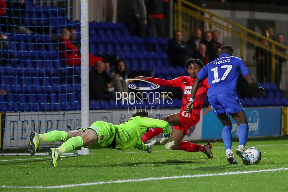 AFC Wimbledon attacker Michael Folivi (17) rounding keeper to score goal during the Leasing.com EFL Trophy match between AFC Wimbledon and Leyton Orient at the Cherry Red Records Stadium, Kingston, England on 8 October 2019.