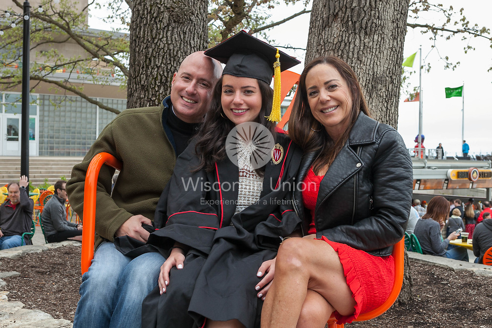 New 2018 graduates test out the Big Terrace Chair at Union South on Graduation Day on Saturday, May 12, 2018.