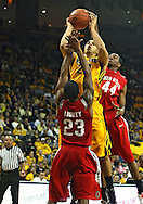 January 27, 2010: Iowa forward Aaron Fuller (24) tries to shoot the ball as Ohio State guard/forward David Lighty (23) and Ohio State guard William Buford (44) defend during the second half of their game at Carver-Hawkeye Arena in Iowa City, Iowa on January 27, 2010. Ohio State defeated Iowa 65-57.