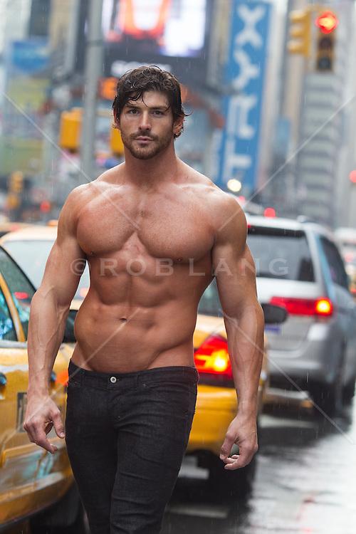 shirtless muscular man walking in New York City