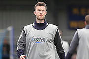 AFC Wimbledon defender Jon Meades (3) warming up during the The FA Cup match between AFC Wimbledon and Charlton Athletic at the Cherry Red Records Stadium, Kingston, England on 3 December 2017. Photo by Matthew Redman.