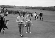 19/08/1967<br /> 08/19/1967<br /> 19 August 1967<br /> Irish Dunlop £1,000 Tournament at Tramore Golf Club, Co. Waterford. A smiling Christy O'Connor marks up his card after a round with A. Skerritt (Waterford).