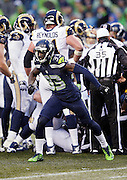Seattle Seahawks defensive back Kelcie McCray (33) pumps his fists as he celebrates after an apparent turnover overturned by officials during the 2015 NFL week 16 regular season football game against the St. Louis Rams on Sunday, Dec. 27, 2015 in Seattle. The Rams won the game 23-17. (©Paul Anthony Spinelli)
