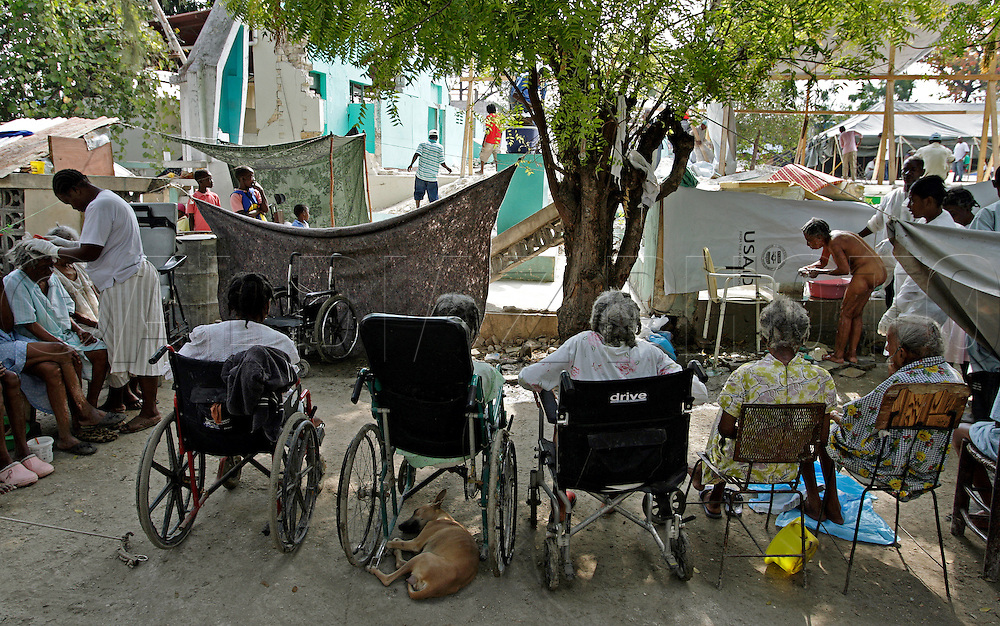 Elderly residents wait to be bathed and grommed outside of the the Municipal Nursing Home in Port-A-Prince near Delmas 2 on February 27, 2010. The nursing home was destroyed during the earthquake and now the general public has encroached on the nursing home site.