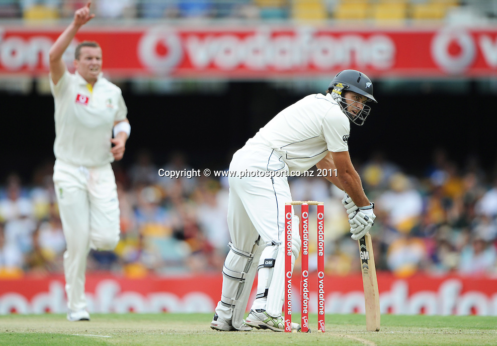 Dean Browlee looks back at Michael Clarke who dropped a chance to dismiss him on Day 1 of the first cricket test between Australia and New Zealand Black Caps at the Gabba in Brisbane, Thursday 1 December 2011. Photo: Andrew Cornaga/Photosport.co.nz