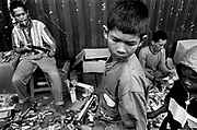 Whilst celebrating Idul Fitri children are given toy guns as presents, symbolic of the gun culture born out of a decades old conflict between GAM and the Indonesian Military, Banda Aceh.