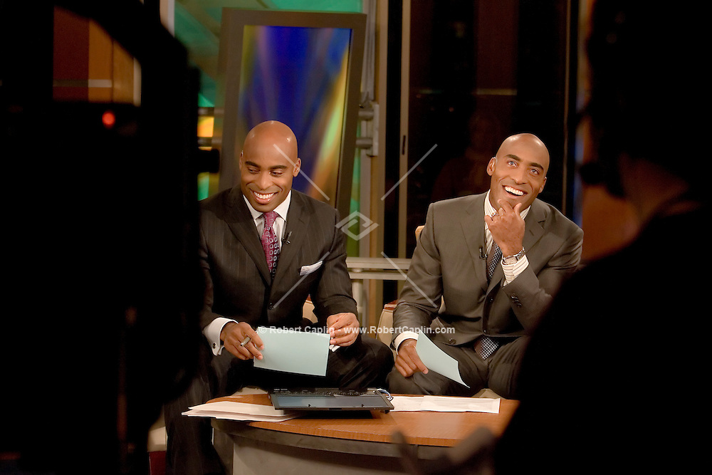"Professional football players and identical twin brothers, Tiki, left, and Ronde Barber, right, make an appearance on FOX and Friends. The Barbers made appearences on FOX News, ESPN2, Good Morning America, and a book signing at Barns and Noble in New York while promoting their third children's book titled ""Teammates"".  Tues. Oct. 17, 2006."