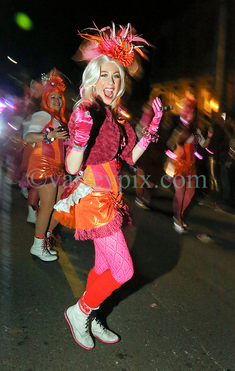 03 February 2016. New Orleans, Louisiana.<br /> Mardi Gras. The Pussyfooters with the all female Mystic Krewe of Nyx as the Krewe parades along Magazine Street.<br /> Photo©; Charlie Varley/varleypix.com