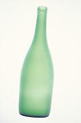still life of tall translucent bottle