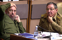 Cuban President Fidel Castro, left, and his brother, the Defense Minister, Raul Castro, attends to the first day of the ordinary session of the National Assembly, celebrated in the Convention Palace on Tuesday December 23, 2003, in Havana, Cuba. (AP Photo/Cristobal Herrera)