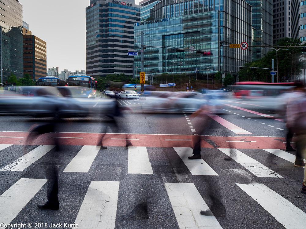08 JUNE 2018 - SEOUL, SOUTH KOREA:  A slow shutter motion blur photo of pedestrians cross Namdaemun Ro in Seoul.      PHOTO BY JACK KURTZ