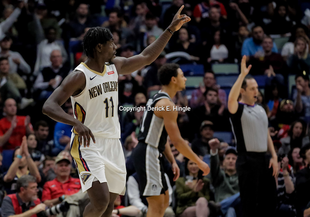 Nov 19, 2018; New Orleans, LA, USA; New Orleans Pelicans guard Jrue Holiday (11) celebrates a basket against the San Antonio Spurs during the second half at the Smoothie King Center. Mandatory Credit: Derick E. Hingle-USA TODAY Sports