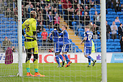 Reading goalkeeper Ali Al-Habsi looks on as Cardiff City forward Kenwyne Jones celebrates with team mates after his goal during the Sky Bet Championship match between Cardiff City and Reading at the Cardiff City Stadium, Cardiff, Wales on 7 November 2015. Photo by Jemma Phillips.
