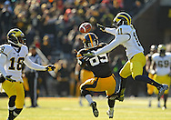 November 23 2013: Iowa Hawkeyes wide receiver Matt VandeBerg (89) tries to pull in a pass as Michigan Wolverines defensive back Blake Countess (18) and Michigan Wolverines cornerback Courtney Avery (11) defend during the second quarter of the NCAA football game between the Michigan Wolverines and the Iowa Hawkeyes at Kinnick Stadium in Iowa City, Iowa on November 23, 2013. Iowa defeated Michigan 24-21.