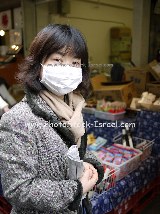 Japan, Tokyo woman with facial surgical mask