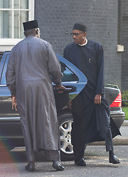 © Licensed to London News Pictures. 23/05/2015. London, UK. President of Nigeria, General Muhammadu Buhari, right, arrives at 10 Downing Street, central London, to meet British Prime Minister David Cameron. Photo credit : Isabel Infantes/LNP