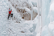 Ice climbers scaling vertical ice in Ouray Ice Park near Ouray, Colorado