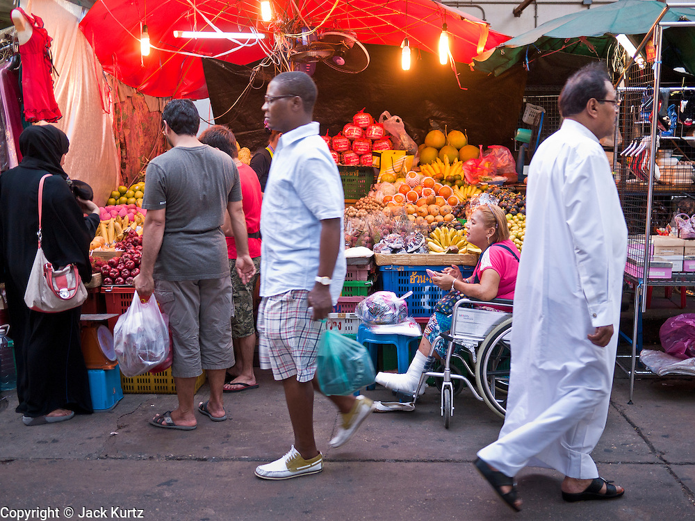 05 JULY 2011 - BANGKOK, THAILAND: Pedestrians walk through the night market on Soi Arab in Bangkok. Soi Arab is an alleyway in Bangkok. What started as an alley has now grown into a neighborhood that encompasses several blocks of restaurants, hotels and money exchanges that cater to Middle Eastern visitors to Thailand. The official name of the street is Sukhumvit Soi 3/1, located in North Nana between Sukhumvit Soi 3 and Sukhumvit Soi 5, not far from the Nana Plaza night-life area and the Grace Hotel popular among Arabs.   PHOTO BY JACK KURTZ