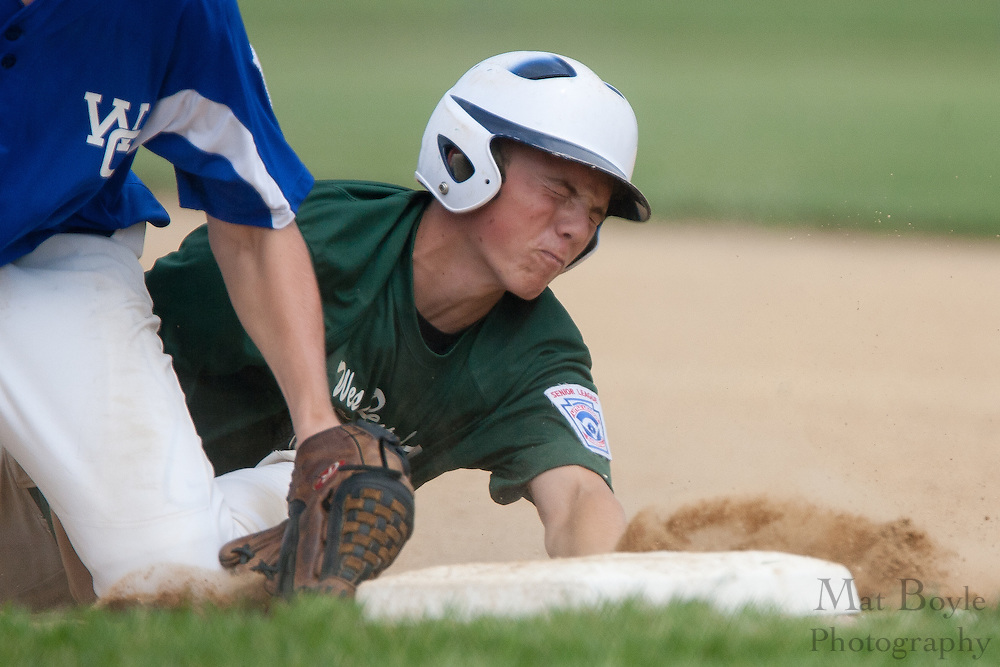 West Deptford's Bobby McSorley dives into first getting tagged out by Waldo County Maine's  Dillon Carliss during a elimination bracket game of the Eastern Regional Senior League tournament held in West Deptford on Sunday, August 7. On the play McSorley would dislocated his finger and leave the game.