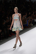 A dress with halter top and cut outs by Richard Chai at the Spring 2013 Mercedes Benz Fashion Week show in New York.