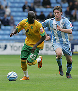 Coventry - Saturday August 9th, 2008: Omar Koromora of Norwich City and Aron Gunnarsson of Coventry City during the Coca Cola Championship match at The Ricoh Arena, Coventry. (Pic by Michael Sedgwick/Focus Images)