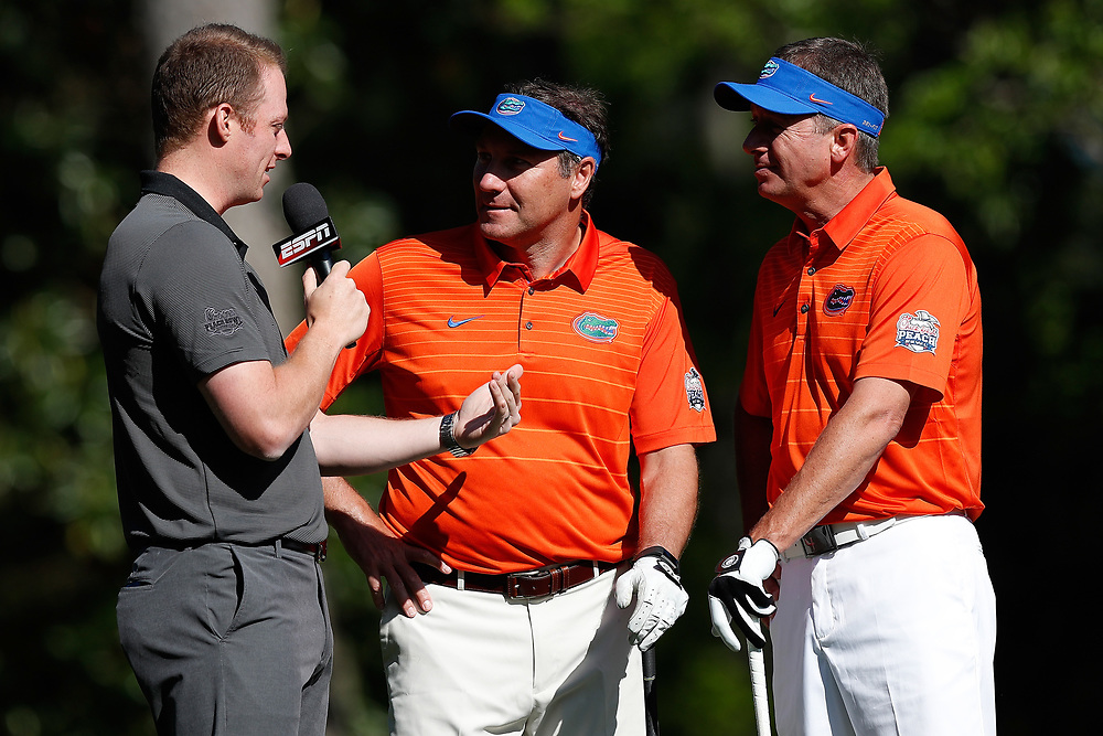 Dan Mullen and Judd Davis talk to ESPN during the Chick-fil-A Peach Bowl Challenge at the Oconee Golf Course at Reynolds Plantation, Sunday, May 1, 2018, in Greensboro, Georgia. (Paul Abell via Abell Images for Chick-fil-A Peach Bowl Challenge)