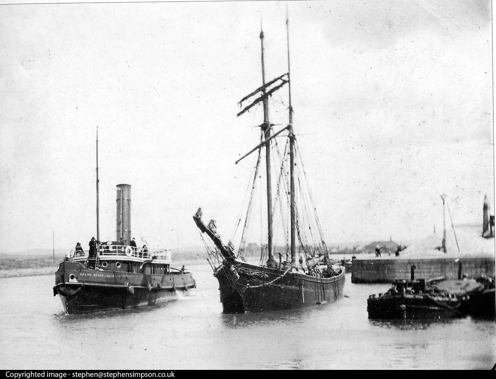 ****COPY HERE****  (https://www.dropbox.com/s/5mg81qiiuy22tre/adamson.rtf?dl=0)   © Licensed to London News Pictures. 02/12/2014. Liverpool , UK . The Daniel Adamson along side a sailing ship in its working days. The only surviving steam powered tug tender, the Daniel Adamson, is being completely renovated by a team of volunteers in Liverpool. The vessel, which has had 90,000 man hours already spent on it, was bought for only one pound is the awaiting the decision of the Heritage LotteryFund on an application of £3.6m to bring her back to her full glory.  . Photo credit : Stephen Simpson/LNP<br /> <br /> COPY HERE https://www.dropbox.com/s/5mg81qiiuy22tre/adamson.rtf?dl=0