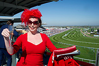 National Hunt Horse Racing - 2017 Randox Grand National Festival - Saturday, Day Three [Grand National Day]<br /> <br /> GV of course with Female racegoer in foreground with red dress, hat &  champagne  before  the 2nd race the 2.25 the Betway Mersey Novices' Hurdle  at Aintree Racecourse.<br /> <br /> COLORSPORT/WINSTON BYNORTH