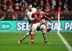 Josh Brownhill of Bristol City battles for the ball with  Luke Shaw of Manchester United  - Mandatory by-line: Joe Meredith/JMP - 20/12/2017 - FOOTBALL - Ashton Gate Stadium - Bristol, England - Bristol City v Manchester United - Carabao Cup Quarter Final