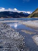 The turquoise waters of the Waimakariri River, with the Puketeraki Range in the background.  New Zealand.