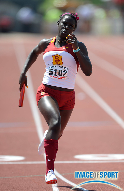 Mar 31, 2012; Austin, TX, USA; Akawkaw Ndipagbor runs the third leg on the Southern California womens 4 x 200m relay that won its heat in 1:33.61 in the 85th Clyde Littlefield Texas Relays at Mike A. Myers Stadium.