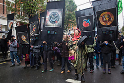 London, UK. 12 October, 2019.  Thousands of climate activists from Extinction Rebellion take part in the XR funeral march from Marble Arch to Russell Square on the sixth day of International Rebellion protests to demand a government declaration of a climate and ecological emergency, a commitment to halting biodiversity loss and net zero carbon emissions by 2025 and for the government to create and be led by the decisions of a Citizens' Assembly on climate and ecological justice. Credit: Mark Kerrison/Alamy Live News