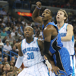 18 February 2009: Orlando Magic center Dwight Howard (12) fights for position over New Orleans Hornets defenders David West (30) and Sean Marks (4) during a NBA basketball game between the Orlando Magic and the New Orleans Hornets at the New Orleans Arena in New Orleans, Louisiana.