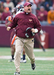 Virginia Tech Hokies defensive coordinator Bud Foster celebrates after his defense stopped UVA to seal the victory.  The Virginia Tech Hokies defeated the Virginia Cavaliers 17-14 in NCAA football at Lane Stadium on the campus of Virginia Tech in Blacksburg, VA on November 29, 2008.