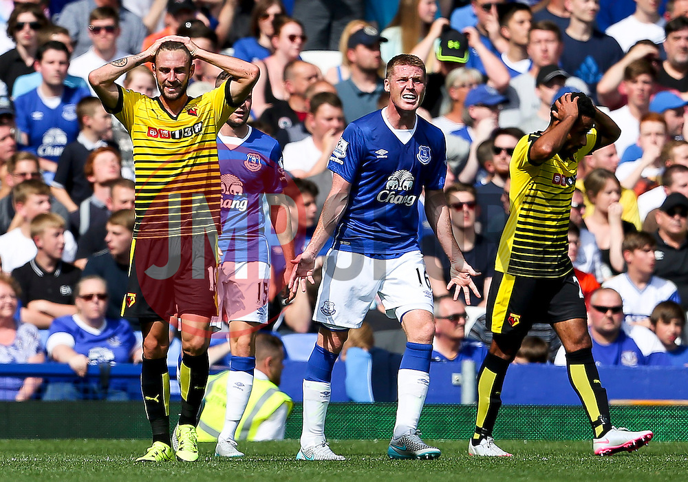 Watford's Miguel Layun reacts after missing a chance as Everton's James McCarthy shouts at his team mates - Mandatory byline: Matt McNulty/JMP - 07966386802 - 08/08/2015 - FOOTBALL - Goodison Park -Liverpool,England - Everton v Watford - Barclays Premier League